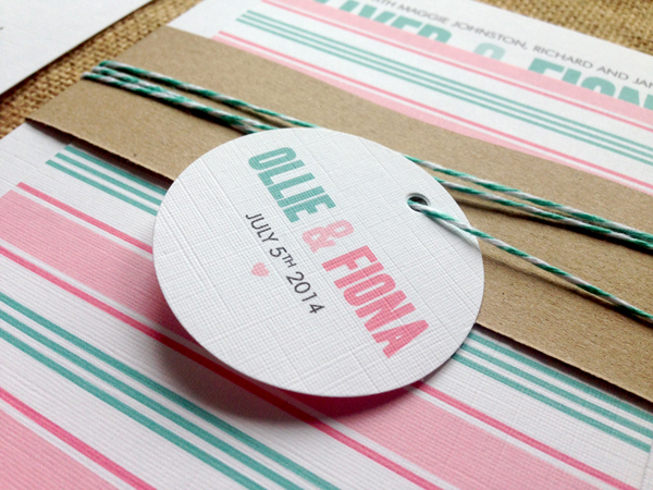Metro-wedding-invitations-in-mint-and-pink-tag-and-twine